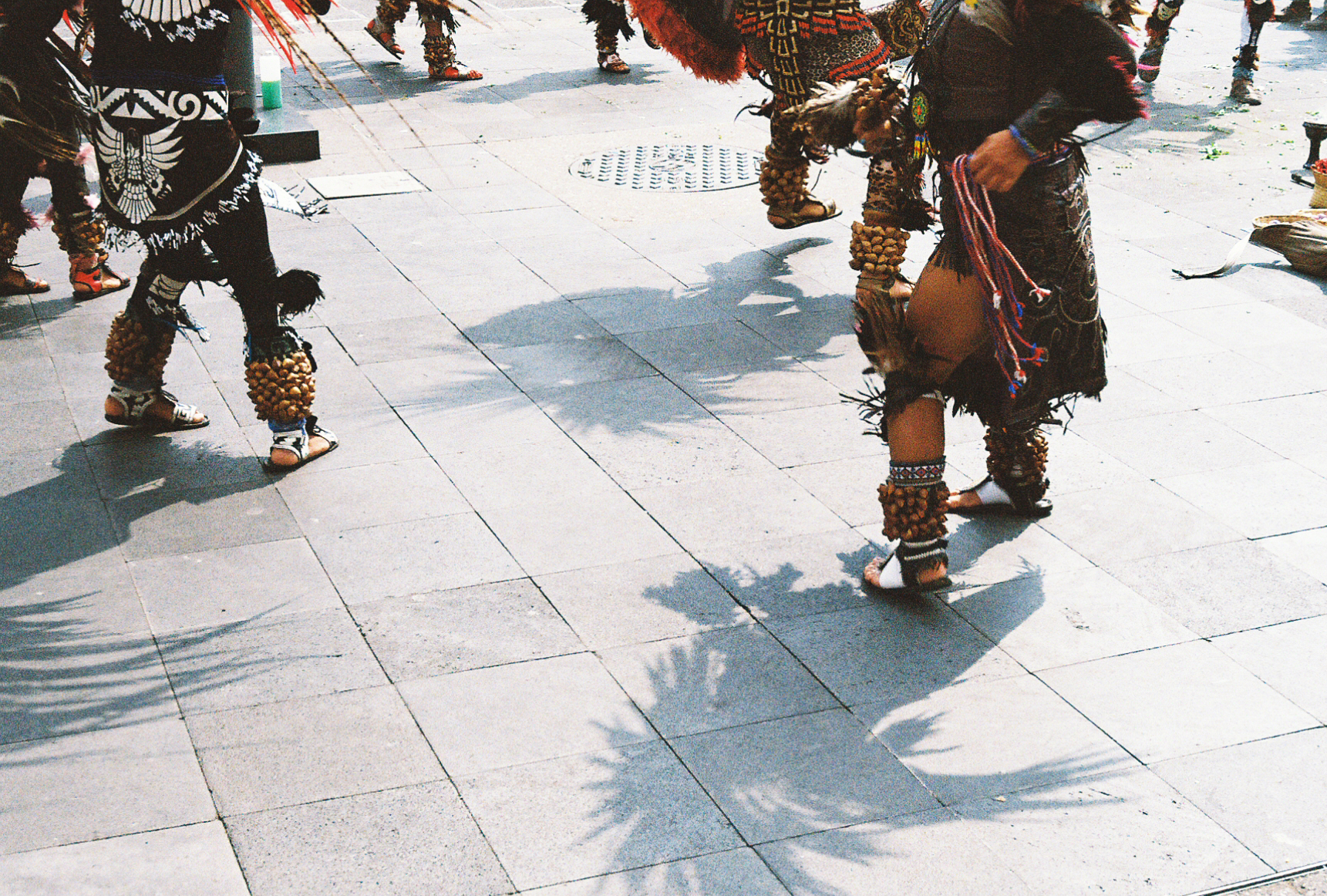 Native Aztecs performing ceremonial dance outside Mexico City Metropolitan Cathedral, shot on 35mm film