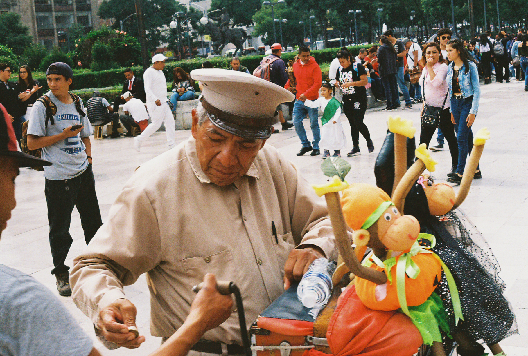 Man playing a music box outside The Metropolitan Cathedral, Mexico City. By Nick Barry