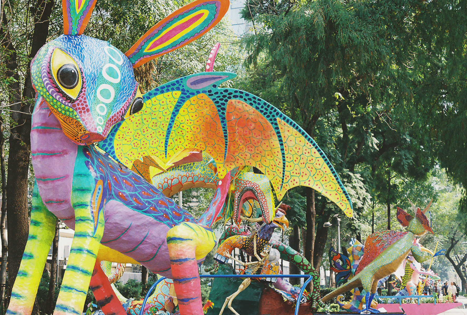 Paper mache sculptures or parade floats brightly painted to represent alebrijes. The spiritual animals of the afterlife. Mexico City. Photographer Nick Barry
