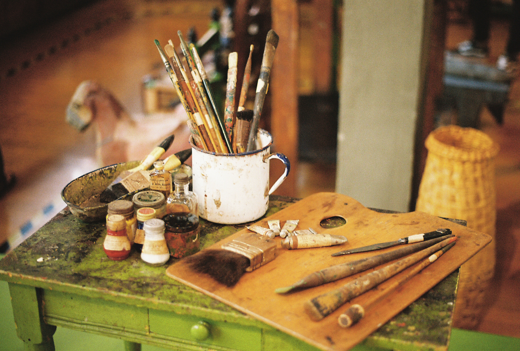 Pigments, paints, brushes and a palette. Inside the studio of Diego Rivera and Frida Kahlo. Mexico City. By Nick Barry, shot on 35mm film.