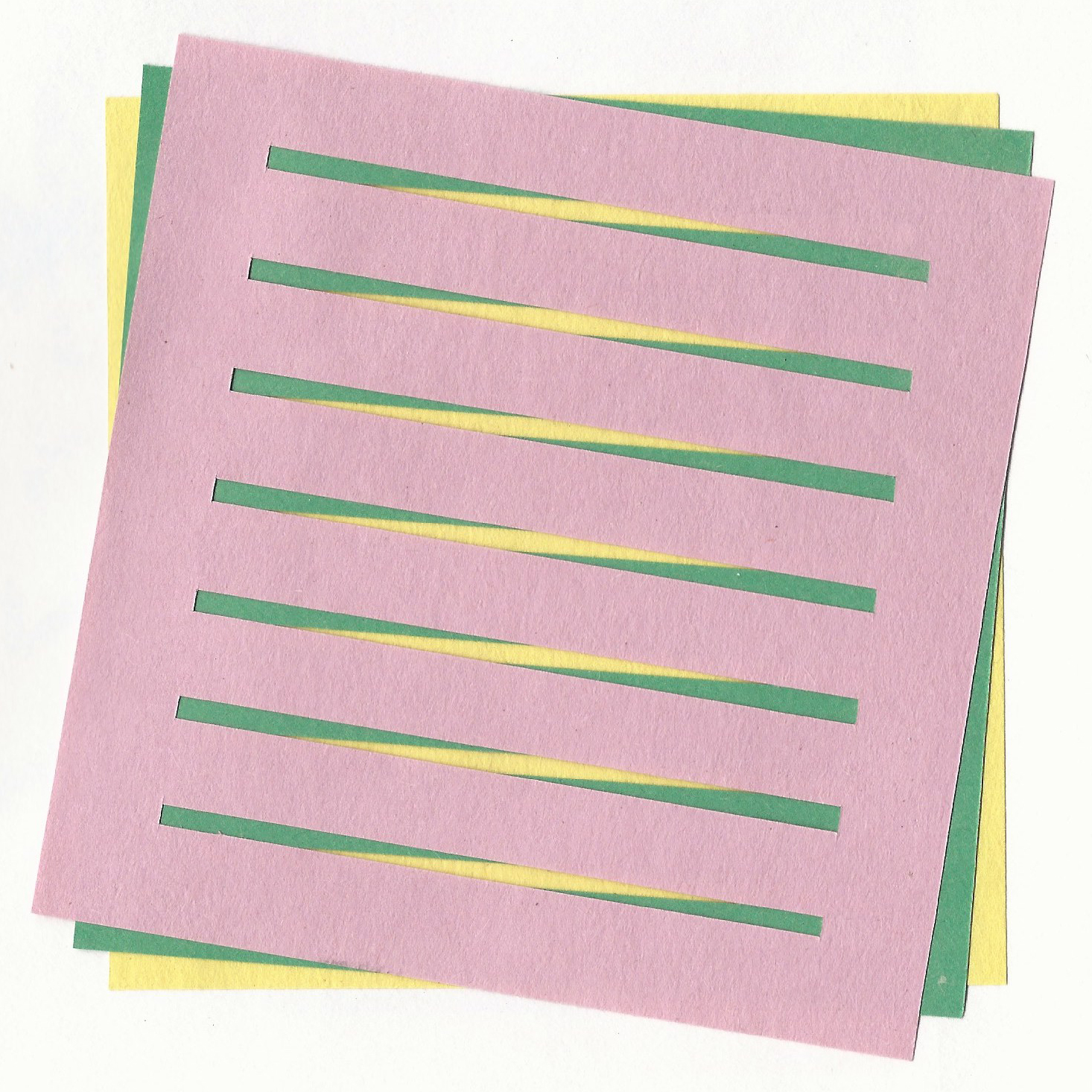 Three identical pieces of paper in three varying colours. Each with slits cut in it, each rotate to create a pattern. By Designer Nick Barry